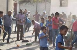 اللجنة الشعبية في خانيونس تطلق حملة  تنظيف وتشجير شوارع منطقة الحاووز