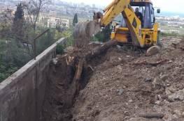 دائرة شؤون اللاجئين بالمنظمة تشرع في البدء بإعادة بناء الحائط الجنوبي لمقبرة مخيم البرج الشمالي