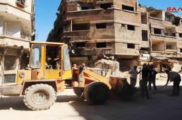 دمشق: انجاز أعمال إزالة الركام والردم من شوارع مخيم اليرموك