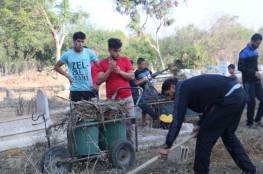 اللجنة الشعبية للاجئين بالبريج تنظم يوم تطوعي لتنظيف شوارع ومقبرة