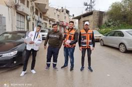 اللجنة الشعبية بمحافظة الخليل تنفذ حملة توعوية وتعقيم الاماكن العامة في مناطق تجمعات اللاجئين في المحافظة